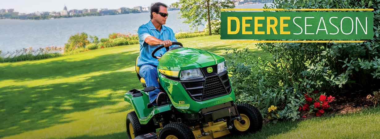 Man mowing on John Deere X330
